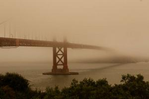 Smoke from wildfires obscures the Golden Gate Bridge